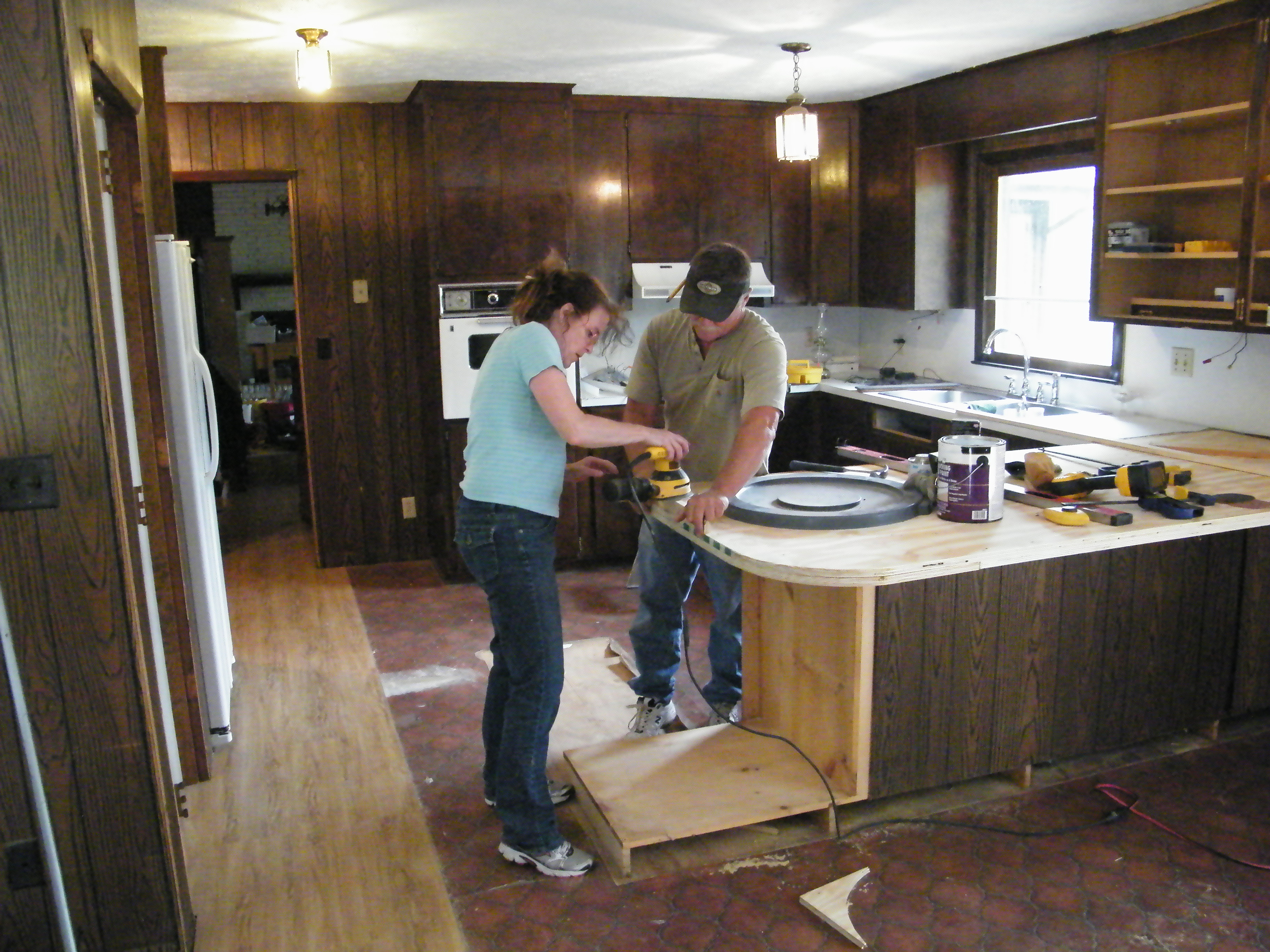 I'm helping to make a new counter-top. We've ripped out (and re-used the  good wood from) 5 removed cabinets. We've opened up the room by first  removing the ...